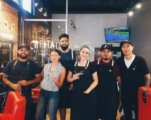The staff at Capital Barbers in the Glebe.