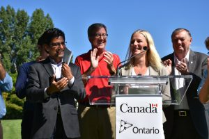 From left: Ottawa MPP Yasir Naqvi, Ottawa Mayor Jim Watson, Ottawa Centre MP Catherine McKenna and Ward 1 Councillor Bob Monette announce $10.5 million in federal funding for the Fifth - Clegg footbridge.